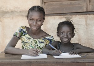 School-For-African-Children--Couple-Smiling-Whilst-Learning-000050812064_Large